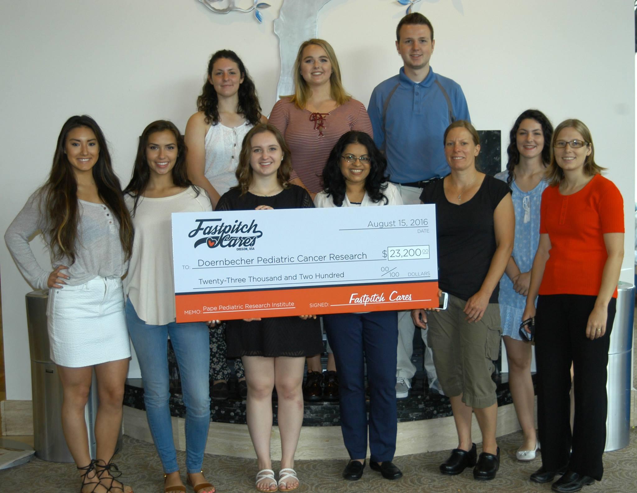 Fastpitch Cares Presents Third Check to Doernbecher Children's Hospital!